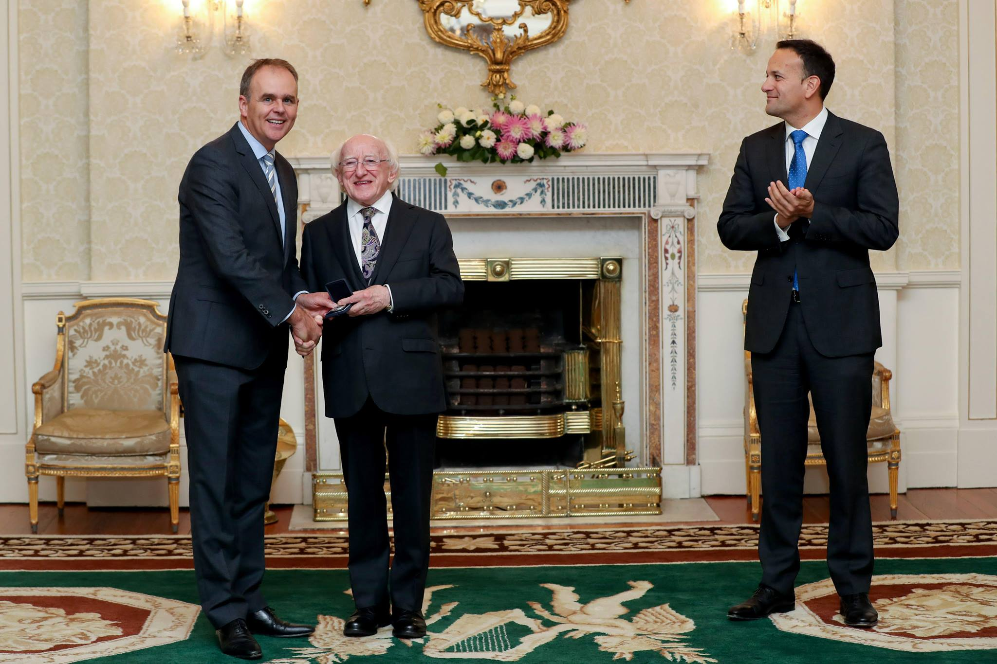Joe McHugh TD (Minister for Education) gets his seal of office from President Higgins at Aras An Uachtarain watched by Taoiseach Leo Varadkar