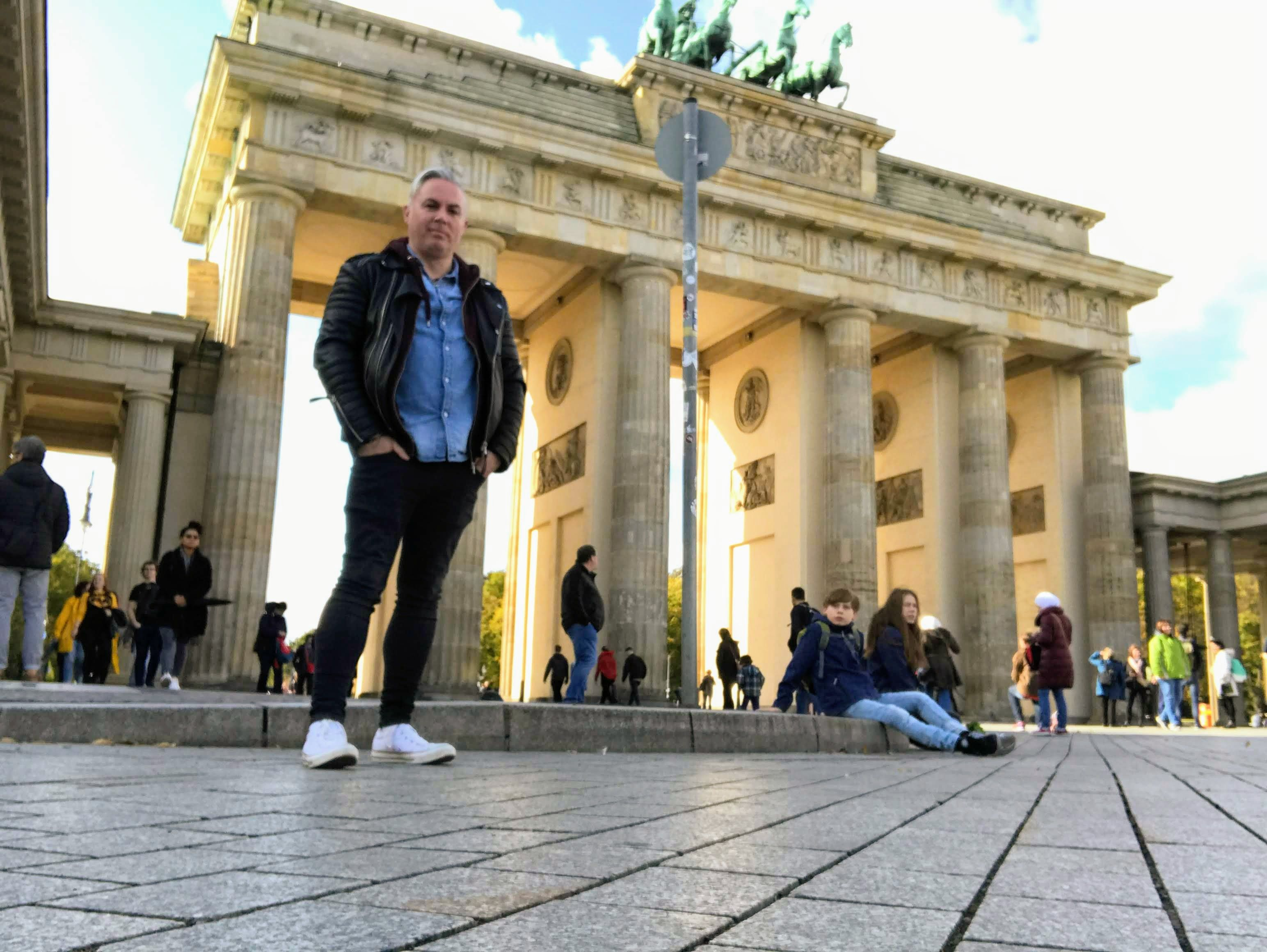 Shane pictured standing in front of the Brandenburg Gate
