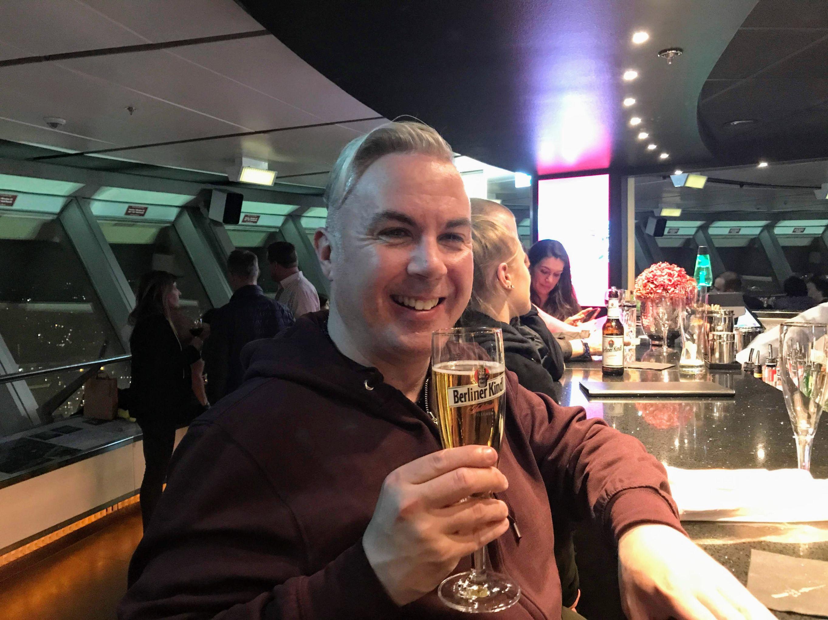 shane smyth drinking a beer at the berlin fernsehturm
